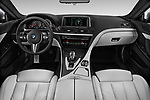 Stock photo of straight dashboard view of 2017 BMW M6 - 2 Door Coupe Dashboard