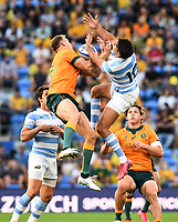 2nd October 2021, Cbus Super Stadium, Gold Coast, Queensland, Australia;  Reece Hodge and Santiago Carreras grapple for the ball. Australian Wallabies versus Argentina Pumas. Rugby Championship test match. Rugby Union. Gold Coast, Australia.