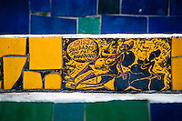 View of a hand painted tile on Selaron's Stairs (Escadaria Selarón), a mosaic staircase made of colorful tiles, in Rio de Janeiro, Brazil, 12 February 2012. World-famous staircase, mostly covered by vibrant yellow, green and blue tiles (inspired by the colors of the Brazilian flag), is the masterpiece of Chilean-born artist Jorge Selarón who considers it as a personal tribute to the Brazilian people. Connecting the neighborhoods of Santa Teresa and Lapa, the stairway is made up of 250 steps and measures 125 meters long. In 1990 Selarón began work on the stairway, creating a constantly evolving piece of art, now adorned with over 2,000 brightly colored tiles collected from over 60 countries. Selarón funds his one man's project through donations and the sale of his black-and-red paintings which mostly depict a pregnant African woman or himself. Living his passion, the eccentric 65-year-old artist claims that this crazy and unique dream will only end on the day of my death.