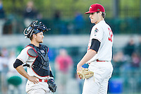 Great Lakes Loons pitcher Nolan Long (52) talks with catcher Brant Whiting (1) on the mound against the South Bend Cubs on May 18, 2016 at Dow Diamond in Midland, Michigan. Great Lakes defeated South Bend 5-4. (Andrew Woolley/Four Seam Images)