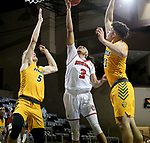 SIOUX FALLS, SD - MARCH 8: Xavier Fuller #3 of the South Dakota Coyotes gets a layup between Sam Griesel #5 Jarius Cook #11 of the North Dakota State Bison during the Summit League Basketball Tournament at the Sanford Pentagon in Sioux Falls, SD. (Photo by Dave Eggen/Inertia)