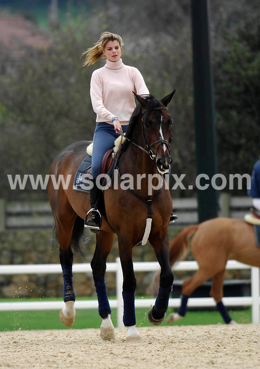 **ALL ROUND PICTURES FROM SOLARPIX.COM**.SYNDICATION RIGHTS FOR UK, CANADA, USA, SOUTH AFRICA, SOUTH AMERICA, DUBAI, AUSTRALIA, NEW ZEALAND, GREECE, ASIA..Greek heiress Athina Onassis de Miranda, with her husband Brazillian olympic professional show jumper Alvaro de Miranda Neto known to friends as Doda Miranda and his daughter, Vivianne de Miranda from his previous marriage at Casas Novas horse trials  in La Coruña, Spain. Doda was competing at the event...DATE: 17/12/2006-JOB REF: 3172-SPA.**MUST CREDIT SOLARPIX.COM OR DOUBLE FEE WILL BE CHARGED**