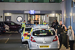 © Joel Goodman - 07973 332324 . 10/08/2017. Salford, UK. Police examine a maroon coloured car in a car park at the rear of the Ibis Hotel in Salford Quays where a young boy was killed in a collision with a car earlier this evening (Thursday 10th August 2017) . Photo credit : Joel Goodman
