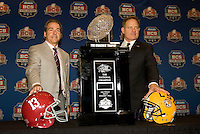 LSU Head Coach Les Miles and Alabama Head Coach Nick Saban pose together for group pictures with BCS National Championship Trophy during BCS National Championship Head Coaches Press Conference at Marriott Hotel at the Convention Center at New Orleans, Louisiana on January 8th, 2012.