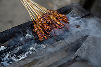 Yogyakarta, Java, Indonesia.  Street Food.  Chicken Kabobs, or Chicken Satay, Grill over a Charcoal Fire.