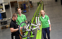 Pictured: Owners Shelley (R) and Jerry Lawson (C) with Jack Appleby (L) on the assembly line Monday 15 August 2016<br />Re: Frog Bikes in Mamhilad Estate Park in Pontypool, Wales, UK