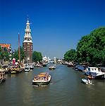 Netherlands, North Holland, Amsterdam: The Montelbaanstoren-Tower on Oudeschans canal | Niederlande, Nordholland, Amsterdam: Wehr- und Verteidigungsturm Montelbaanstoren am Oudeschans Kanal