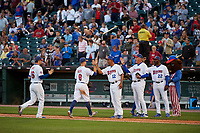 Buffalo Bisons manager Bob Meacham (12), pitching coach Bob Stanley (46), hitting coach Devon White (22) and mascot Buster T. Bison high five Jon Berti (8) and Shane Opitz (16) after a game against the Syracuse Chiefs on July 3, 2017 at Coca-Cola Field in Buffalo, New York.  Buffalo defeated Syracuse 6-2.  (Mike Janes/Four Seam Images)