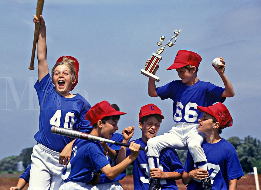 Boys celebrate Little League baseball victory.