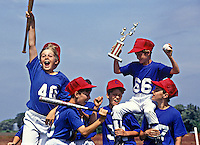 Boys celebrate Little League baseball victory.