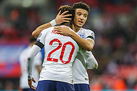 Callum Hudson-Odoi (Chelsea) of England and Jadon Sancho (Borussia Dortmund) of England embrace after the UEFA 2020 Euro Qualifier match between England and Czech Republic at Wembley Stadium, London, England on 22 March 2019. Photo by David Horn.