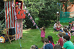 Punch and Judy Show at Petersham village fete Richmond Surrey. UK. 2010s 2011 UK