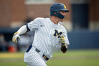 Michigan Wolverines shortstop Benjamin Sems (2) rounds first base during NCAA baseball action against the Ohio State Buckeyes on April 10, 2021 at Ray Fisher Stadium in Ann Arbor, Michigan. The Wolverines defeated the Buckeyes 7-0. (Andrew Woolley/Four Seam Images)