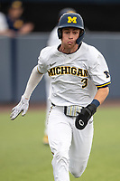 Michigan Wolverines designated hitter Ted Burton (3) sprints towards the plate against the Ohio State Buckeyes on April 9, 2021 in NCAA baseball action at Ray Fisher Stadium in Ann Arbor, Michigan. Ohio State beat the Wolverines 7-4. (Andrew Woolley/Four Seam Images)
