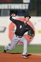 Aaron Cressley #9 of the Eugene Emeralds pitches against the Salem-Keizer Volcanoes at Volcanoes Stadium on July 27, 2014 in Keizer, Oregon. Salem-Keizer defeated Eugene, 9-1. (Larry Goren/Four Seam Images)