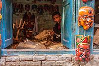 Nepal, Patan.  Mask-carver at Work in his Workshop.