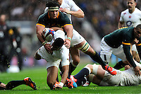Anthony Watson of England is tackled by Marcell Coetzee of South Africa just short of the tryline during the QBE International match between England and South Africa at Twickenham Stadium on Saturday 15th November 2014 (Photo by Rob Munro)