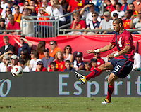 USA defender   Oguchi Onyewu (5) passes the ball. In a friendly match, Spain defeated USA, 4-0, at Gillette Stadium on June 4, 2011.