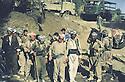 Iran 1983 July in Haj Omran, Mohammed Saleh Goma and Mullazem Ali with peshmerga. Behind them, trucks of the Iranian army  Irak 1983 Juillet a Haj Omran, peshmergas du PDK avec Mohammed Saleh Goma et Mullazem Ali. Derriere eux des camions de l'armee iranienne