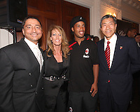 Will Chang and fiends pose with Ronaldinho of AC Milan at a reception for AC Milan at DAR Constitution Hall in Washington DC on May 24 2010.
