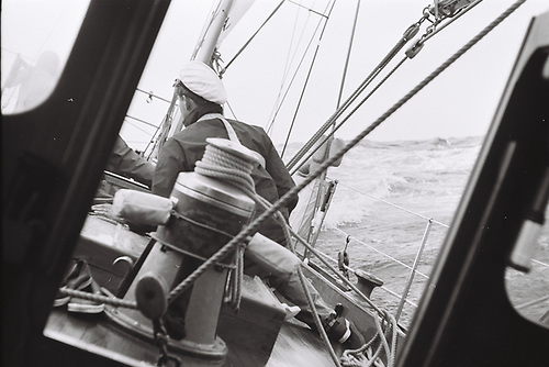 Racing against the weather – open water, harnesses on, and sheets just cracked as we make knots for Land's End Photo: W M Nixon