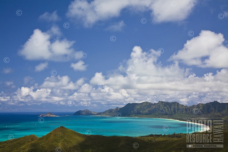 White sand beach in Waimanalo Bay with Koolau mountains in the background