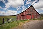 Weathered red wooden barn, Sierra Valley, Loyalton, Calif.