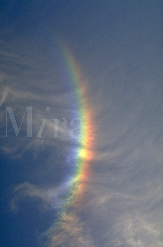 Cirrus clouds; light refraction by ice crystals in cloud; rainbow. Houston Texas.