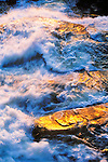 South Fork of the Tuolumne River swollen with snowmelt sparkles in the setting sun, Yosemite National Park, Calif.