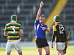Stephan Mc Donnell of Glen Rovers and Cathal Doohan  of Ballyea get a yellow card from referee Johnny Murphy during their Munster Club hurling final at Thurles. Photograph by John Kelly.
