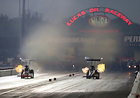 Aug 30, 2014; Clermont, IN, USA; NHRA top fuel dragster driver Khalid Albalooshi (right) races alongside T.J. Zizzo during qualifying for the US Nationals at Lucas Oil Raceway. Mandatory Credit: Mark J. Rebilas-USA TODAY Sports