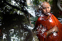 U Wirathu, the spiritual leader of the Buddhist nationalist 969 Movement prepares to get into a vehicle outside the New Maesoeyin Monastery in Mandalay. U Wirathu is an abbot in the New Maesoeyin Monastery where he leads about 60 monks and has influence over more than 2,500 residing there. He travels the country giving sermons to religious and laypeople encouraging Buddhists to shun Muslim business and communities. /Felix Features