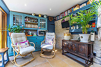 BNPS.co.uk (01202 558833)<br /> Pic: Strutt&Parker/BNPS<br /> <br /> Pictured: Snug corner makes for the perfect reading spot. <br /> <br /> An 18th century cottage in 'the prettiest village in England' is on the market for £675,000.<br /> <br /> Number 2 School Lane is Grade II listed, built with beautiful Cotswold stone and filled with character features like exposed timber beams and original fireplaces.<br /> <br /> The attractive three-bedroom property is in the highly sought after Wiltshire village of Castle Combe.<br /> <br /> The quintessentially English village has been used regularly as a film location and the houses are mostly made with honey-coloured Cotswold stone.