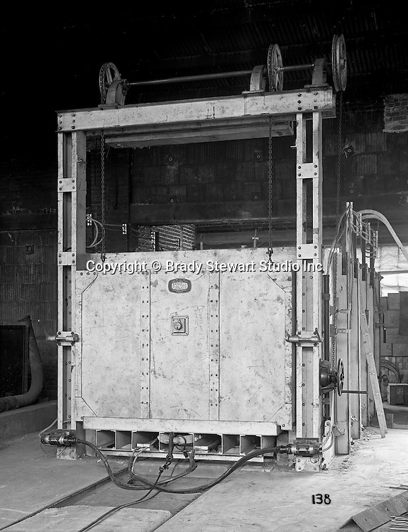 """Client: William Swindell & Brothers<br /> Ad Agency: George Ketchum Advertising<br /> Contact: George Ketchum<br /> Product: Car Type Electric Heat Treatment Furnace<br /> Location: Swindell Brothers factory in Pittsburgh <br /> <br /> View of William Swindell Brothers Car type Electric Heat Treating Furnace. For this client, Brady Stewart used an Eastman Kodak Mod. 2-D View Camera.  All the negatives in this gallery are 8""""x10"""" and still in great condition in 2020.<br /> <br /> Swindell Dressler International Company was based in Pittsburgh, Pennsylvania. The company was founded by Phillip Dressler in 1915 as American Dressler Tunnel Kilns, Inc.  In 1930, American Dressler Tunnel Kilns, Inc. merged with William Swindell and Brothers to form Swindell-Dressler Corporation. The Swindell brothers designed, built, and repaired metallurgical furnaces for the steel and aluminum industries. The new company offered extensive heat-treating capabilities to heavy industry worldwide."""
