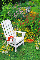 Perfect lunch in the garden-- tomatoes and more tomatoes-- in a gorgeous place to sit and a cheerful birdhouse
