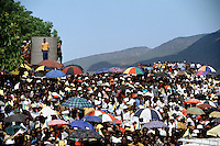 Crowds listen to Nelson Mandela at a campaign event.  After more then 27 years in jail as an anti-apartheid activist,   Nelson Mandela lead a 1994 campaign for President as a member of the African National Congress (ANC),  in the first free elections in South Africa in 1994.  Mandela has received more than 250 awards over four decades, including the 1993 Nobel Peace Prize.