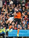 Dundee Utd's and Dundee Utd's Callum Morris challenge for the ball.