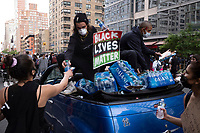 NEW YORK, NEW YORK - JUNE 2: People hand out water to marchers during a protest against the death of George Floyd on June 2, 2020 in New York. The protests spread across the country in at least 30 cities across the United States, over the death of unarmed black man George Floyd at the hands of a police officer, this is the latest death in a series of police deaths of black Americans. (Photo by Stephen Ferry /VIEWpress via Getty Images)
