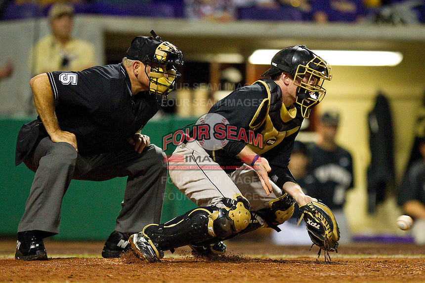 Catcher Mike Lubanski #10 of the Wake Forest Demon Deacons blocks a low pitch against the LSU Tigers at Alex Box Stadium on February 18, 2011 in Baton Rouge, Louisiana.  The Tigers defeated the Demon Deacons 15-4.  Photo by Brian Westerholt / Four Seam Images