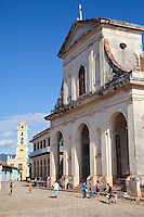 Cuba, Trinidad.  Church of the Holy Trinity on the right, completed 1892.  Bell Tower of the Church and Convent of San Francisco in the background, now the entrance to the Museo de la Lucha contra Bandidos (Museum of the Struggle against Counter-revolutionaries.
