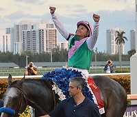 HALLANDALE, FL - JANUARY 28: Jockey Mike Smith celebrates atop Arrogate after winning The Inaugural $12 Million Pegasus World Cup Invitational, The World's Richest Thoroughbred Horse Race at Gulfstream Park on January 28, 2017 in Hallandale, Florida <br /> <br /> People:  Arrogate, Mike Smith