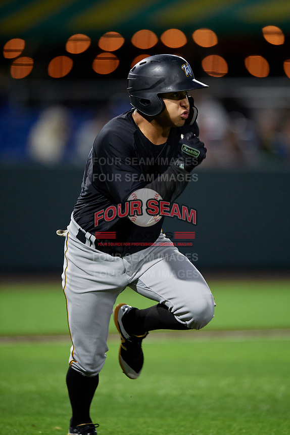 West Virginia Black Bears Fernando Villegas (25) runs to first base during a NY-Penn League game against the Auburn Doubledays on August 23, 2019 at Falcon Park in Auburn, New York.  West Virginia defeated Auburn 6-5, the second game of a doubleheader.  (Mike Janes/Four Seam Images)