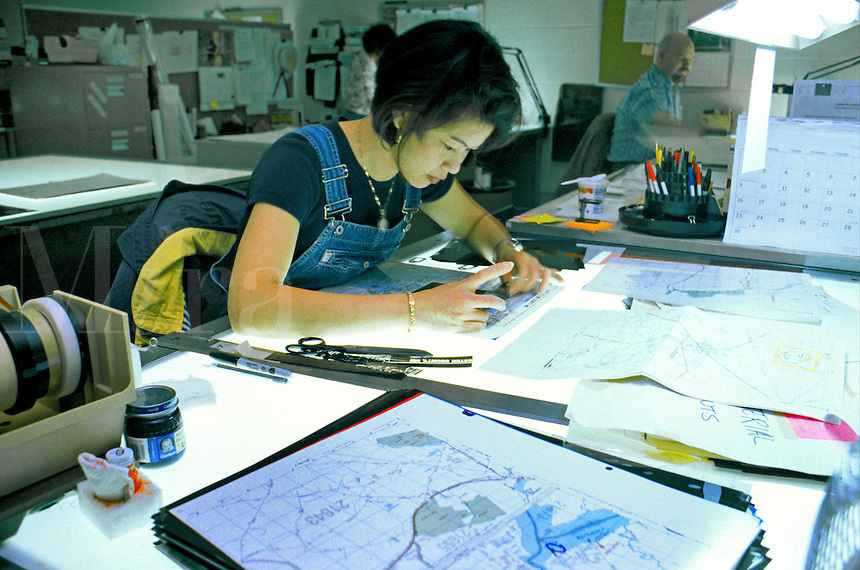 Asian female cartographer working on street map