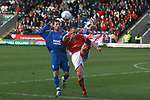 Rochdale 4, Accrington Stanley 2, 03/03/2007. Scotland, EFL League 2. Rochdale (blue shirts) play visitors Accrington Stanley in a League Two fixture at Spotland, Rochdale. Both sides were struggling near the foot of the division and facing the prospect of relegation from the Football League. Rochdale won this match by four goals to two, having lead three-nil at half-time. Picture shows Stanley's Alan Rogers clearing from on-loan Rochdale striker Adam Le Fondre. The game was watched by a crowd of 3343. Photo by Colin McPherson.