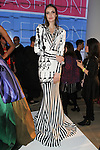 Model poses in an outfit from the Leornardo Mena collection during the Epson Digital Couture Fall Winter 2017 fashion presentation on February 7, 2017 in the IAC Building, during New York Fashion Week Women Fall 2017.
