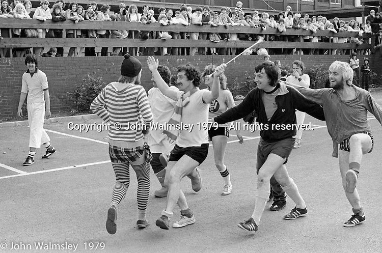 Staff dress up and play a daft game of football, Festival & Gala Day at the Education Centre, Wester Hailes, Scotland, 1979.  John Walmsley was Photographer in Residence at the Education Centre for three weeks in 1979.  The Education Centre was, at the time, Scotland's largest purpose built community High School open all day every day for all ages from primary to adults.  The town of Wester Hailes, a few miles to the south west of Edinburgh, was built in the early 1970s mostly of blocks of flats and high rises.
