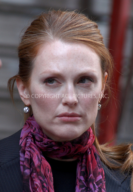 """Julianne Moore filming """"Laws of Attraction"""" in New York. August 18, 2003. Please byline: NY Photo Press.   ..*PAY-PER-USE*      ....NY Photo Press:  ..phone (646) 267-6913;   ..e-mail: info@nyphotopress.com"""