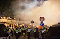 Tear gas is fired by police at pro-democracy protesters on the first day of Occupy Hong Kong, outside the Hong Kong government headquarters, Admiralty, Hong Kong, China, 29 September 2014. Several areas of the city including Central, Admiralty, Causeway Bay, as well as Mong Kok in Kowloon, were locked down by Occupy Central civil disobedience teams who fanned out across the city blocking major thoroughfares as well as side streets, with rip ties, metal barriers, police road cones and any other street furniture available to hand.