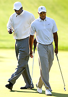 NBA legend Michael Jordan and professional golfer Tiger Woods play a practice round of golf during the 2007 Wachovia Championships at Quail Hollow Country Club in Charlotte, NC.