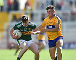 Jack O Connor of Kerry in action against Adam O'Connor of Clare during their Munster Minor football final at Pairc Ui Chaoimh. Photograph by John Kelly.
